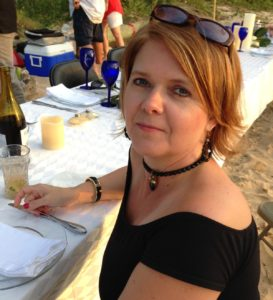 Mimi Woodham Dining on Beach with Friends