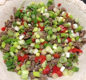 Pie shell with sausage, green onions and pimentos