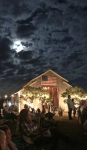 Moon at night at Weeks Bay Plantation barn with American Flag www.diningwithmimi.com