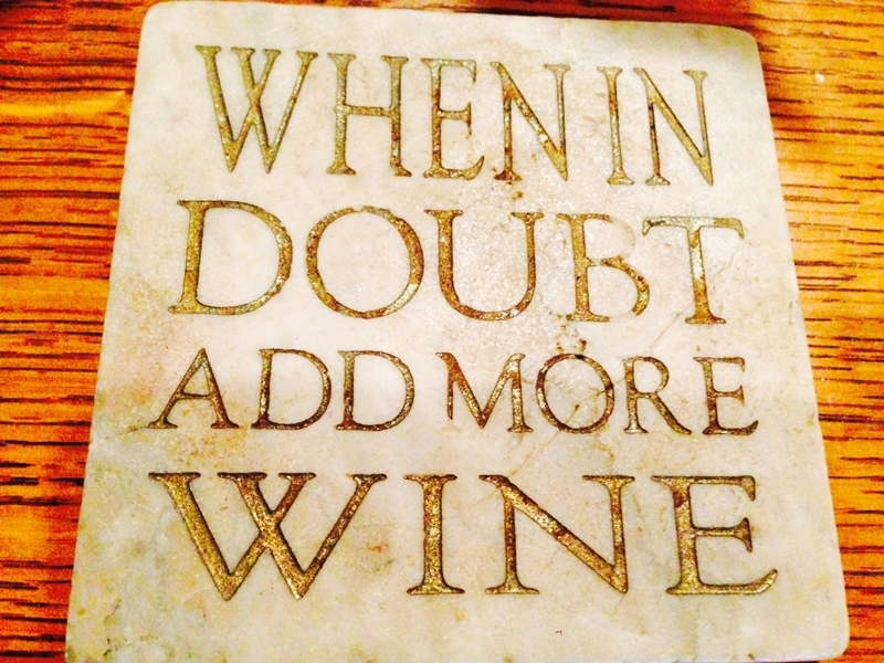 "Sign on stone ""When in Doubt Add More Wine"" www.diningwithmimi.com"