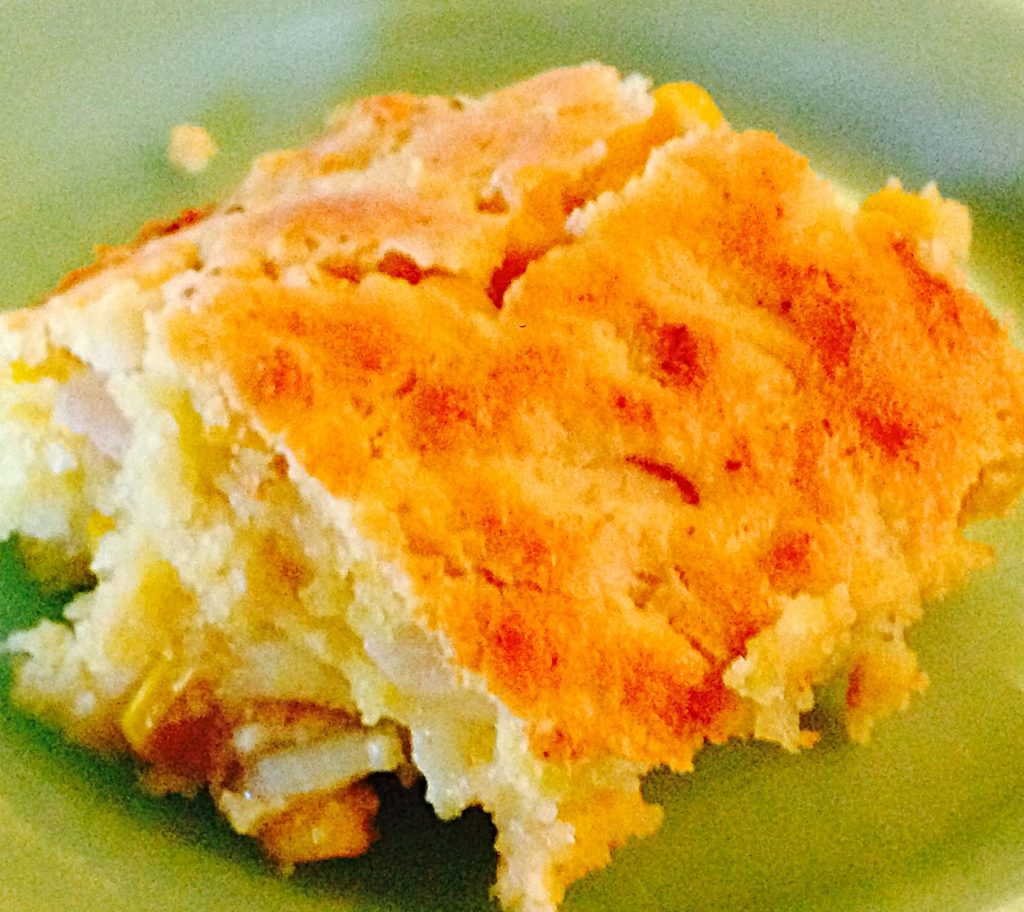 Golden scoop of hot cornbread ozzing with cheese www.diningwithmimi.com