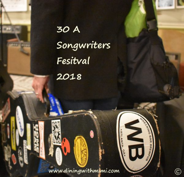 Guitar Man holding his instrument Songwriters Festival 2018 www.diningwithmimi.com