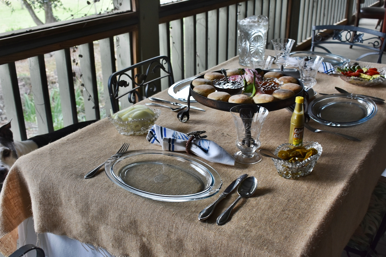 Porch table setting for Drowning Seasoned Pork Roast in Yesterday's Wine www.diningwithmimi.com