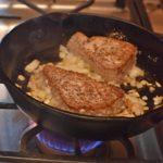 Steaks in hot skillet for Raw Ahi tuna for Seasoned Ahi Tuna Steaks Sear Then Flip Recipe www.diningwithmimi.com