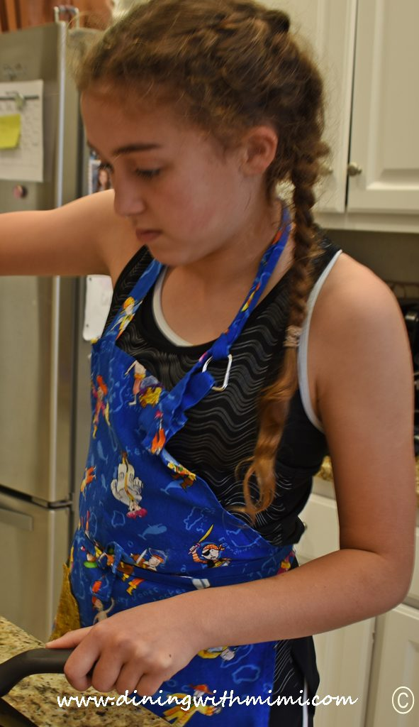 Young girl in apron cooking Can you slice, dice and whip it good? www.diningwithmimi.com