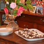 Serve dessert on platter for Nutty Fudgy Indulgent Pecan Bar www.diningwithmimi.com