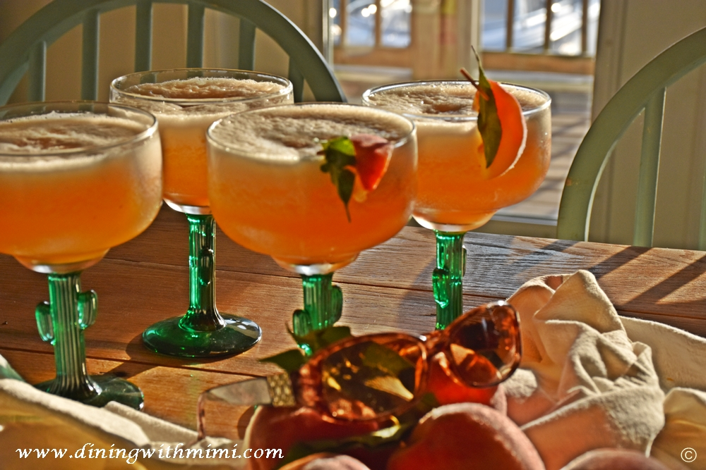 4 Frozen Drinks on table Mango Driving Me Crazy with fresh peaches served for Fish to Table- Sriracha Kissed Fresh Snapper and More www.diningwithmimi.com