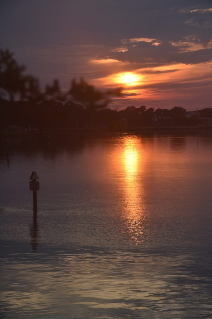 Sunset reflecting on water for My Dauphin Island Restorative Paddle www.diningwithmimi.com