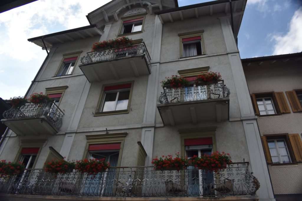 Flower boxes on balcony for Dazed by Engelberg in July www.diningwithmimi.com