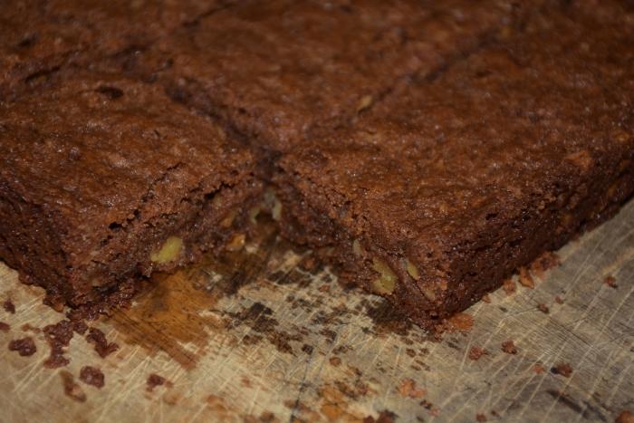 Nutty Fudgy Indulgent Brownies on cutting board www.diningwithmimi.com
